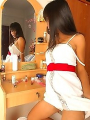 Thai Cutie watching herself in mirror