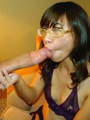 Thai babe loves sucking on huge stiff cock